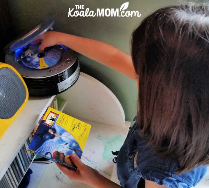 7-year-old Jade puts the Swan Lake CD in her CD player.