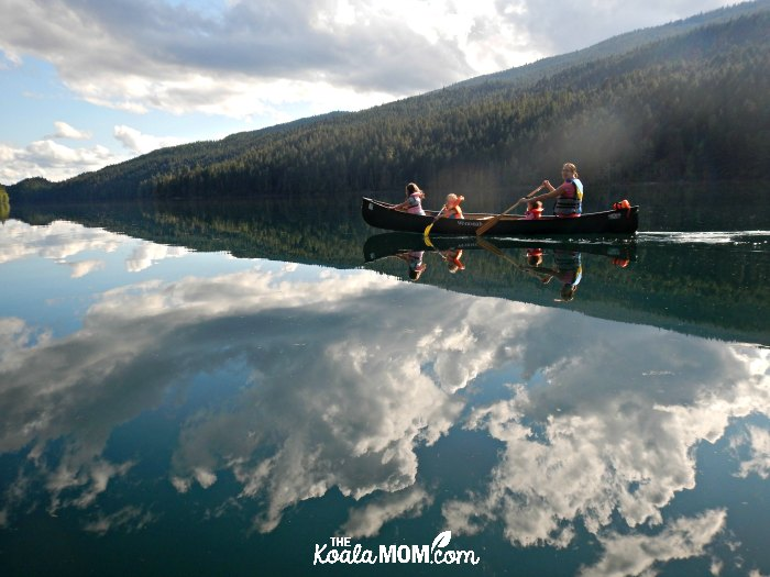 Bonnie and her daughters in a canoe on Clearwater Lake