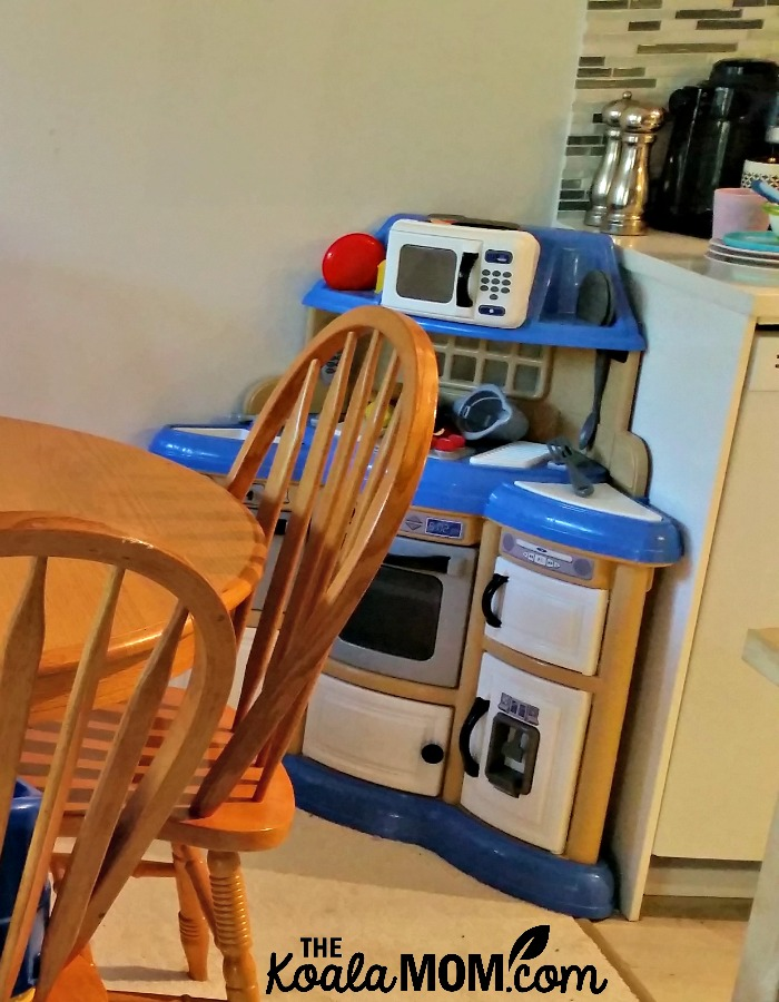 A toddler kitchen in the corner of our kitchen and dining room