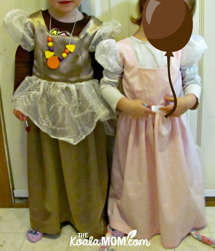 Two girls in their saint princess costumes, ready to party