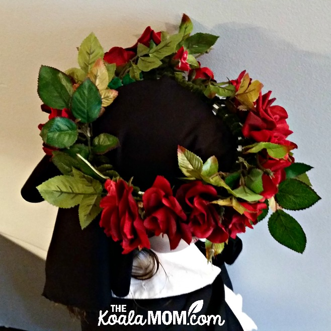 Saint Rose of Lima costume - a wreath of roses over a girl's head