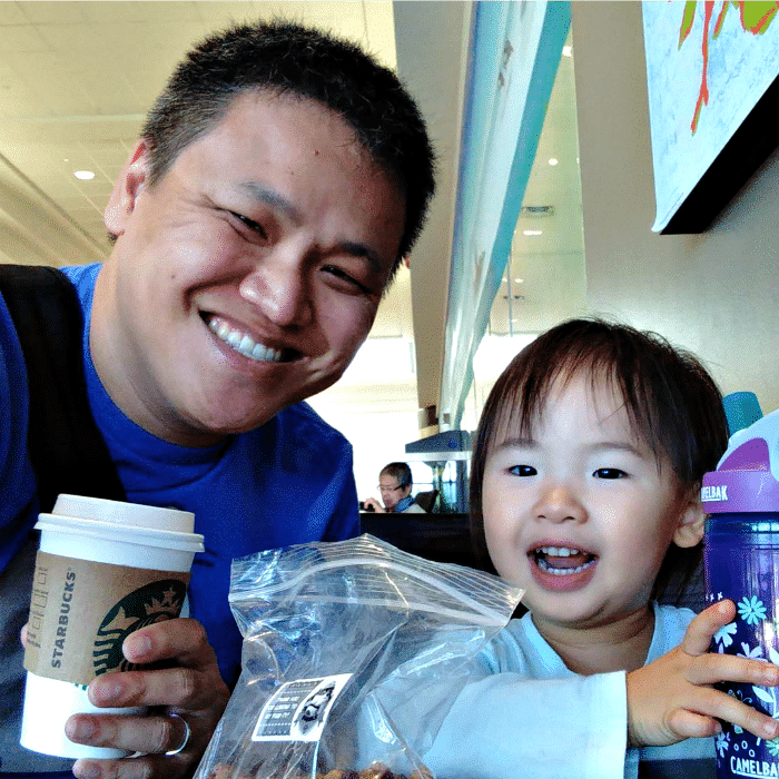 Dad blogger and freelance writer Michael Kwan with his daughter