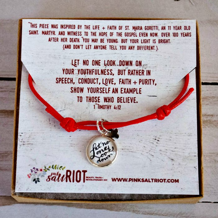 """Let No One Look Down on You Because of Your Youth"" red cord bracelet for young girls from Pink Salt Riot"
