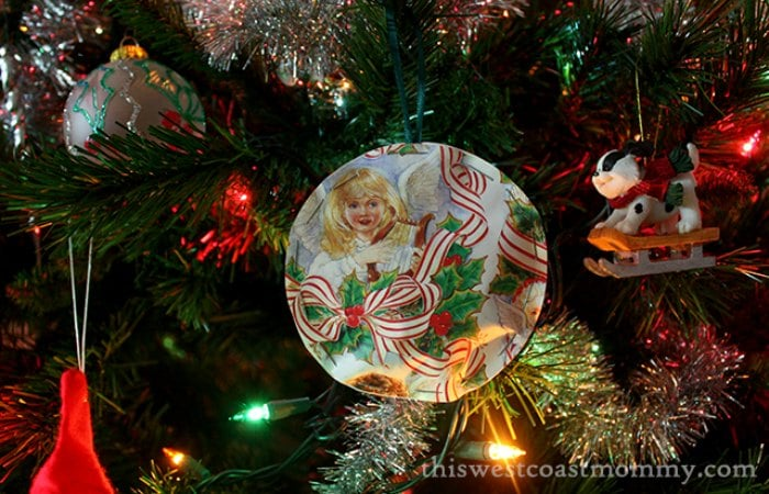Upcycled wrapping paper ornaments on Christmas tree