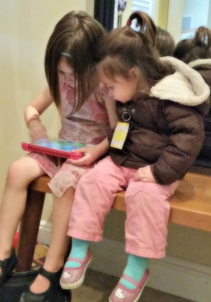 Jade (4) and Pearl (2) playing together on my tablet while we're waiting for big sister's music lessons.