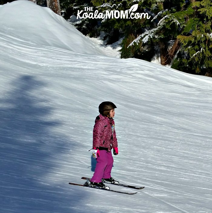 7-year-old Lily skiing down the hill.