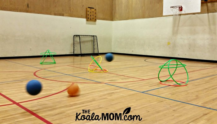 Balls bouncing toward hula hoops during one of the Sportball kids sports classes.