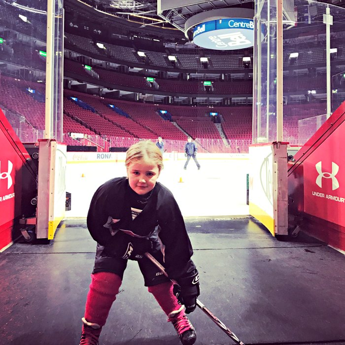 Six-year-old girl playing hockey
