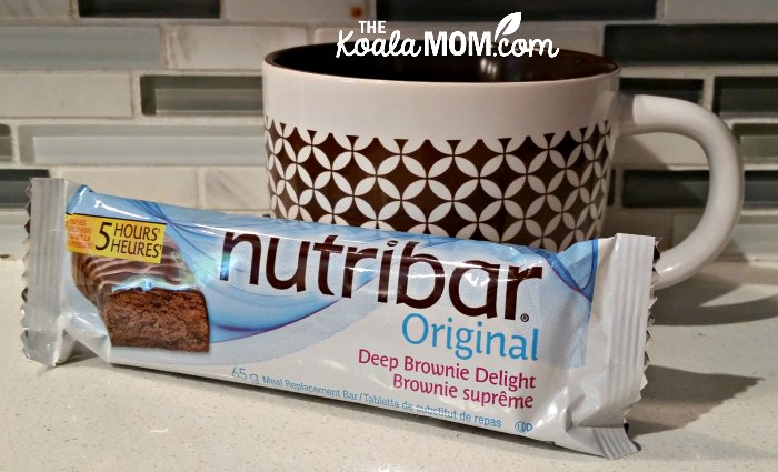 Nutribar deep brownie delight meal replacement bar with a coffee cup