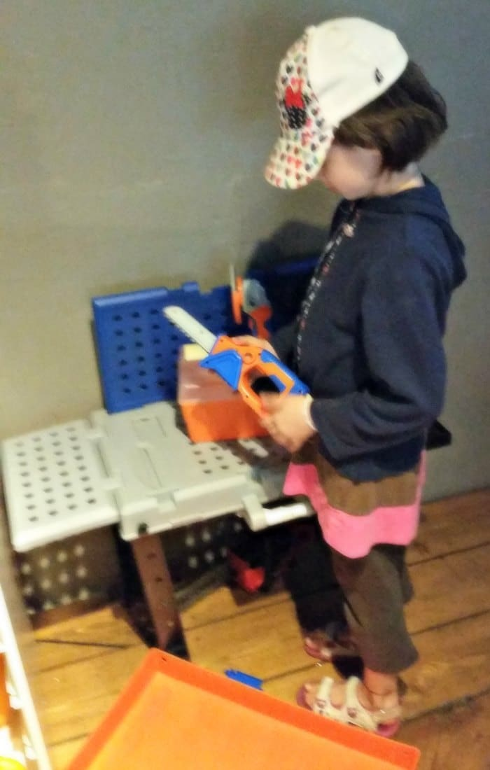 Lily plays with a toy toolbox in the kids' play area at the Blenheim Pub in Vancouver, BC