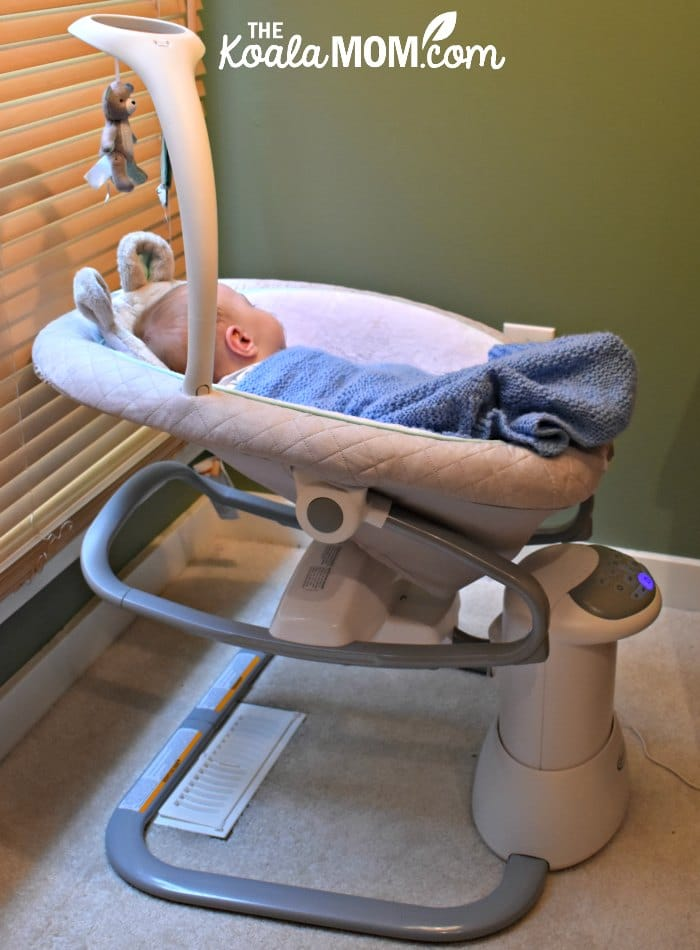 A baby boy sleeps in his Graco Everyway Soother.
