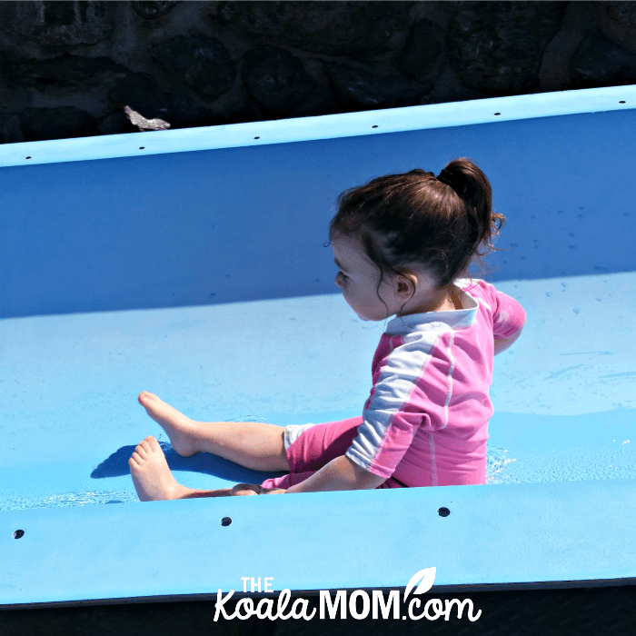 Toddler rides a slide at the Cultus Lake Waterpark.