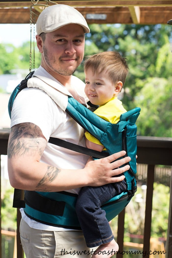 Dad using a MiaMily Hipster Baby Carrier to carry his toddler son