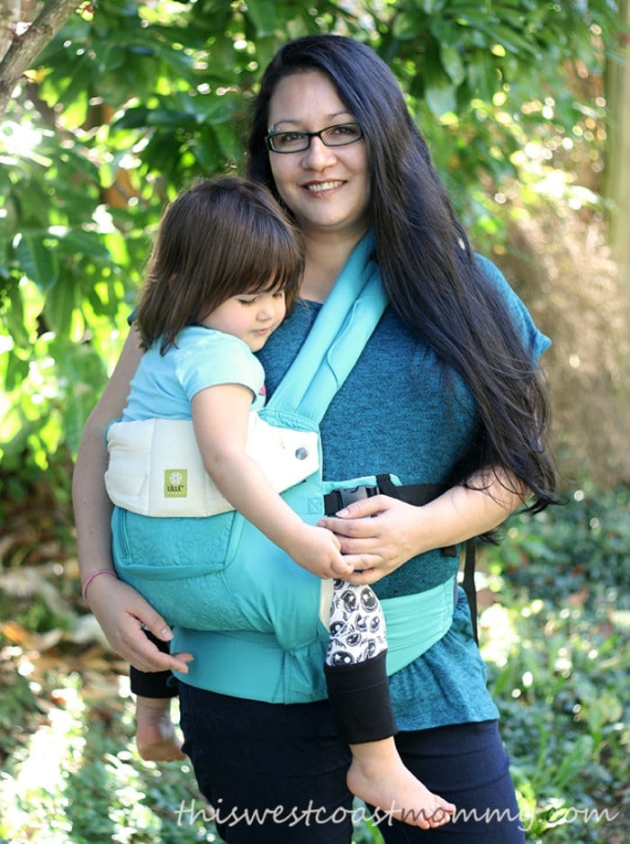 Olivia carries her three-year-old in a LILLEbaby Complete Carrier hip carry