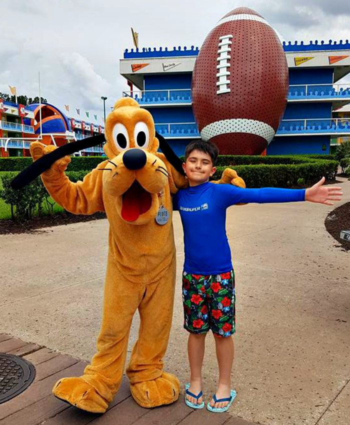 Boy hugging Goofy at Walt Disney World Resort