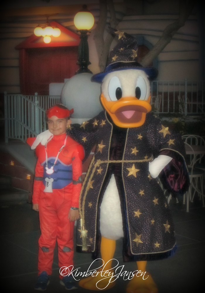 Posing with Donald Duck at Mickey's Halloween Party at the Disneyland Resort.