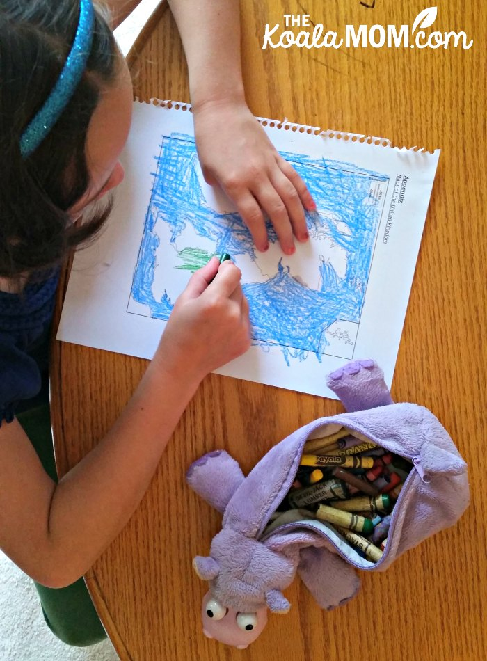Lily working on a map from her Picture Book Explorers pack on Paddington Bear, one of the lit-based unit studies from Branch Out World