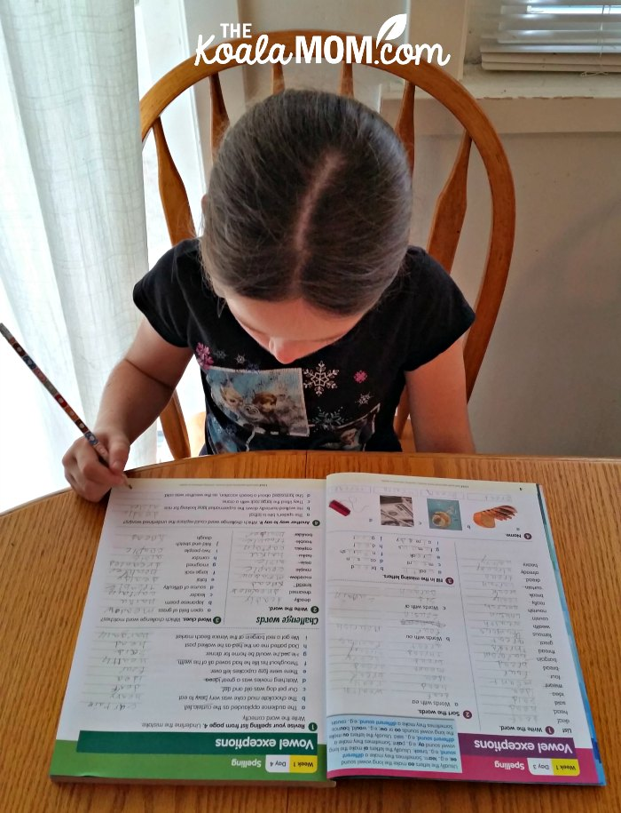 Sunshine doing her 200 Essential Reading Skills for Fith Grade workbook from Reading Eggs.