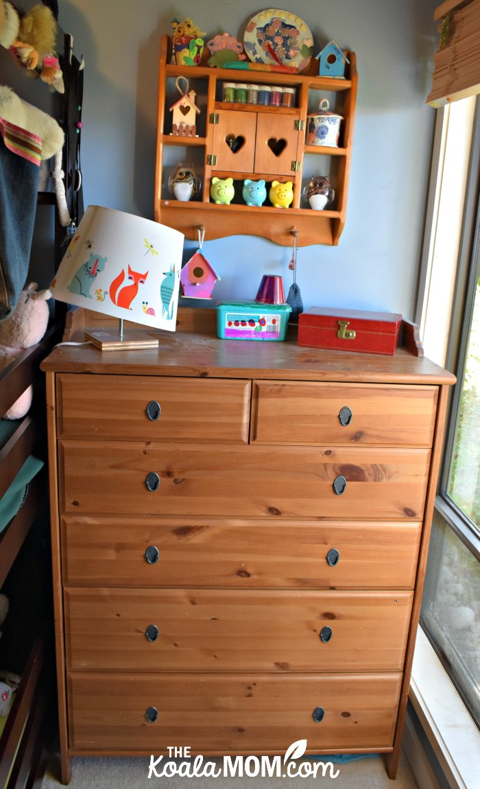 Ikea dresser with a kids' lamp on top.