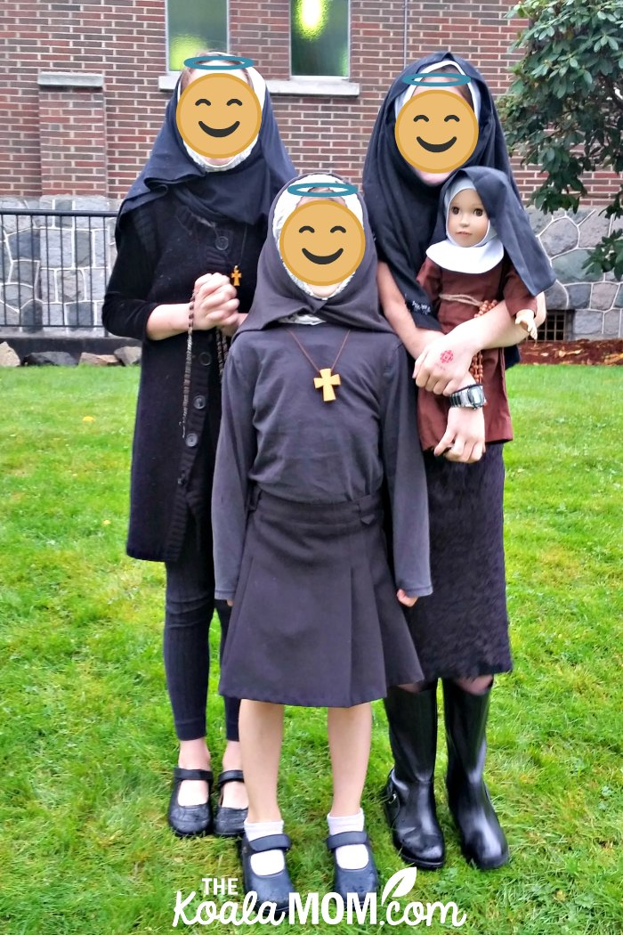 Three girls dressed up as nuns for our Canadian All Saints Day Party.