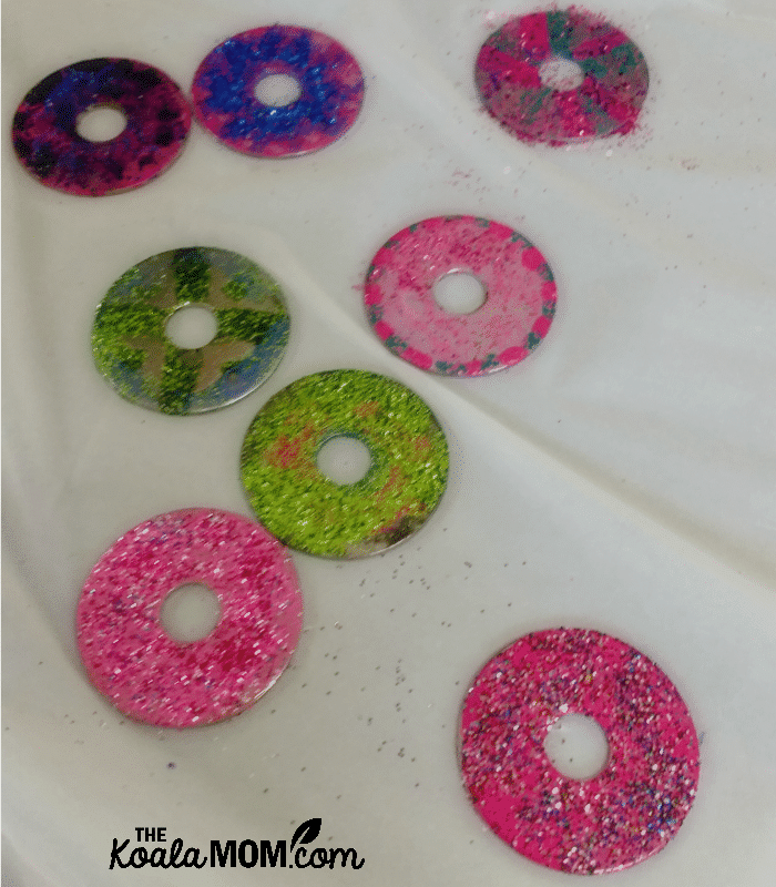Washers decorated with nail polish and glitter for the St. Joseph medal craft at our Canadian All Saints Day Party
