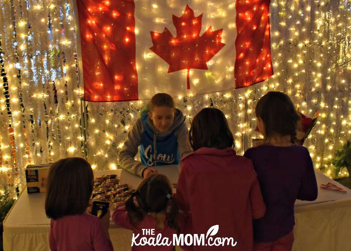Claiming maze prizes at the Canada booth at Christmas Glow.