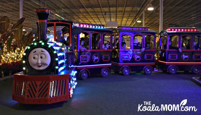 Children riding the Glowcomotive at Christmas Glow in Langley.