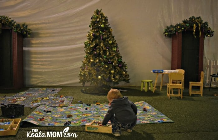 Toddler play area with cars, colouring, and more at Christmas Glow.