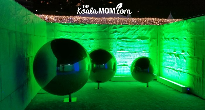 Green reflecting balls in the winter maze at the Aurora Winter Festival in downtown Vancouver.