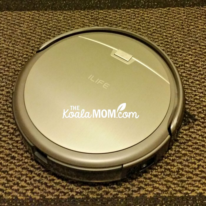 My iLife Robot Vacuum at work on the carpet.