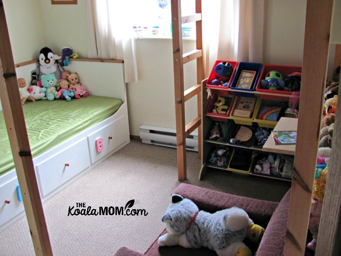 A loft bed saves space in a bedroom by raising the bed off the floor to provide room underneath for other furniture.