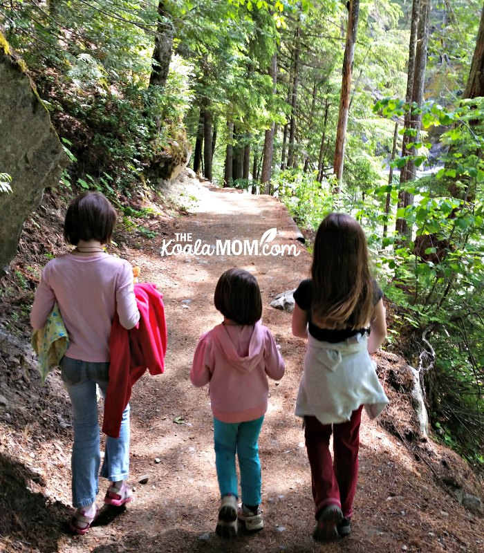 Three girls hiking on the trail to Nairn Falls.