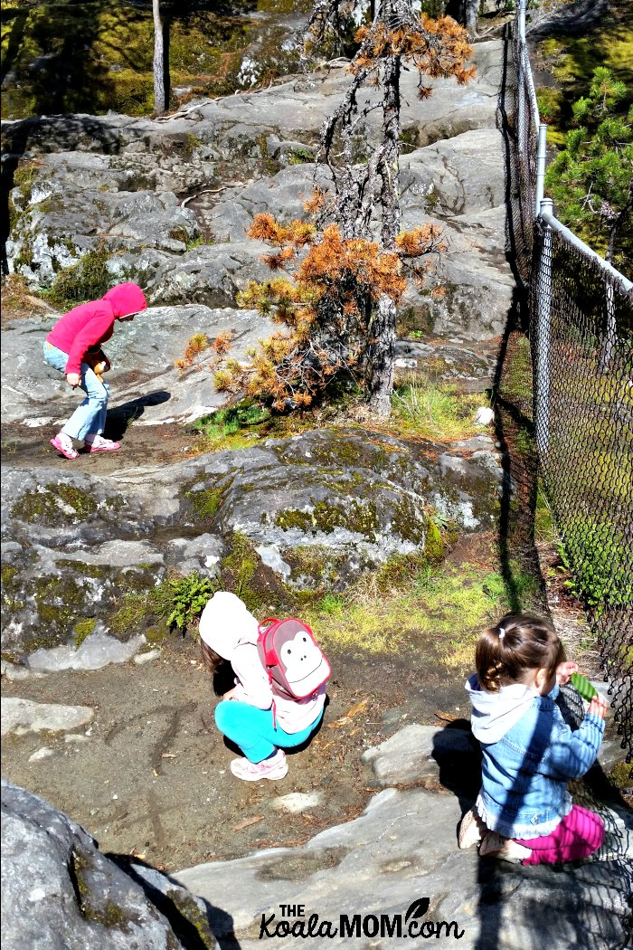 Three girls exploring at Nairn Falls.