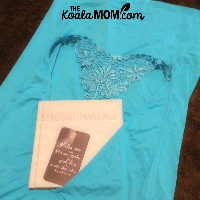 Pretty blue lingerie with a book on sensual massage for a hot night with your hubby.