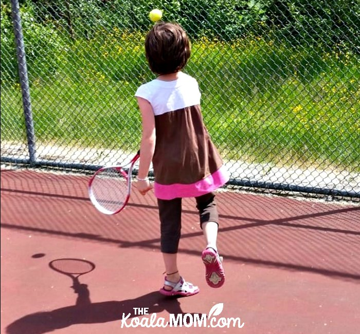 Girl playing tennis, a great free recreational activity around greater Vancouver.