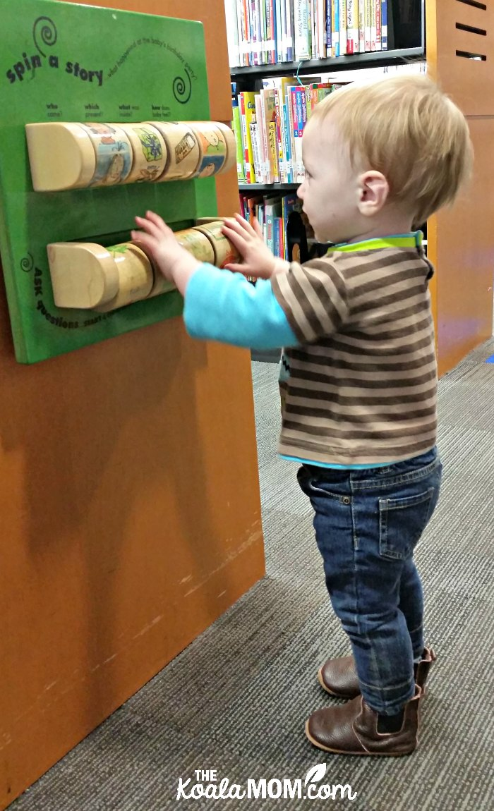 Baby playing at library.