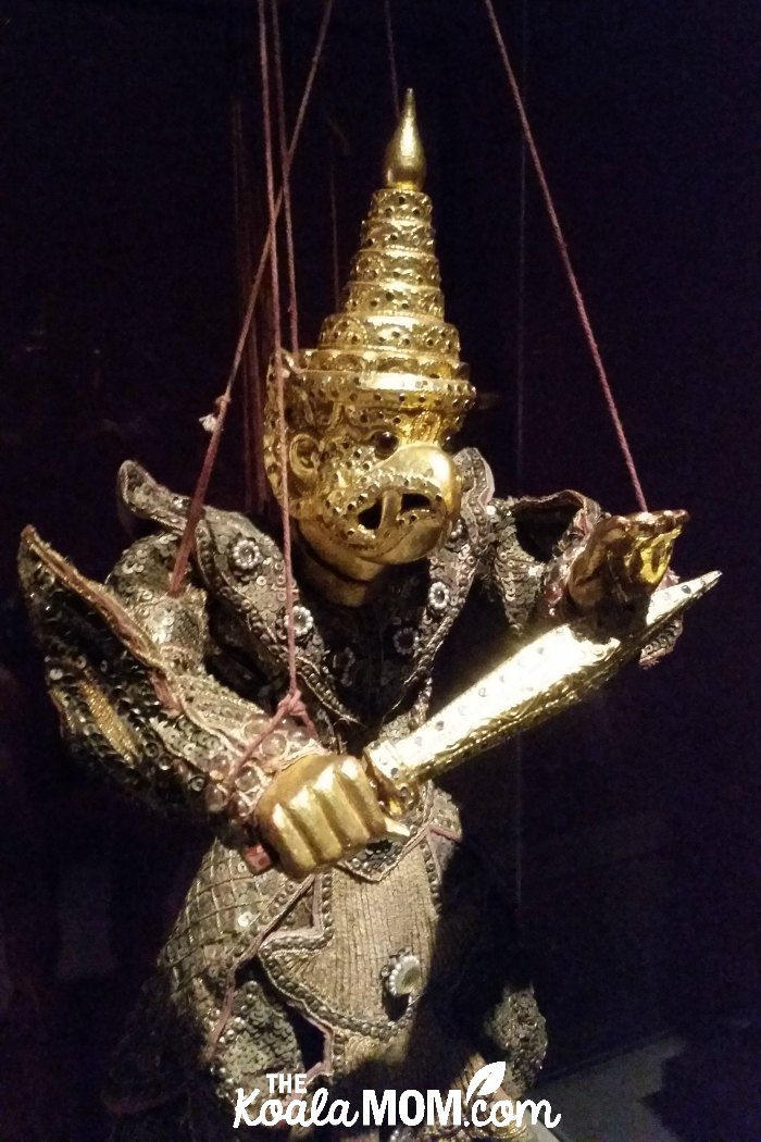 Gold bird warrior string puppet at UBC's MOA.