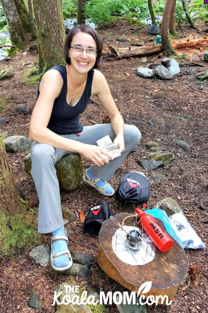Bonnie Way cooking supper over her backpacking stove.