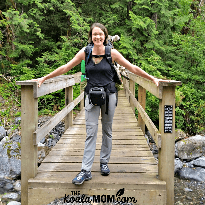 Bonnie Way standing on a bridge on the West Canyon Trail while backpacking in Golden Ears.