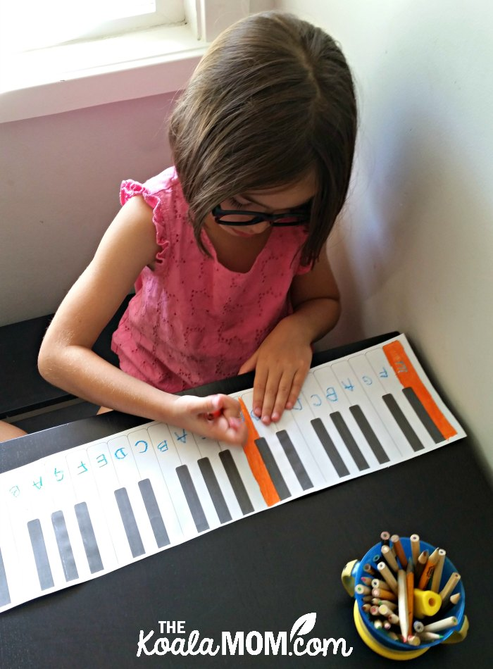 6-year-old colouring her paper piano.