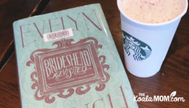 Brideshead Revisited by Evelen Waugh, on a table at Starbucks with a coffee nearby.