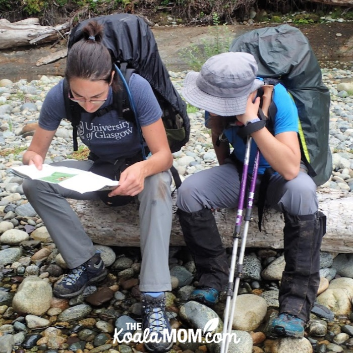 Bonnie and her friend looking at their West Coast Trail map.