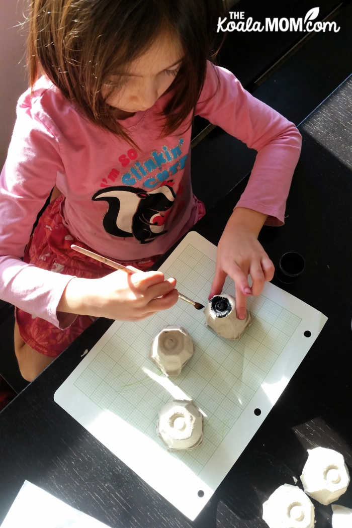 Grade 1 student making an egg carton ant.