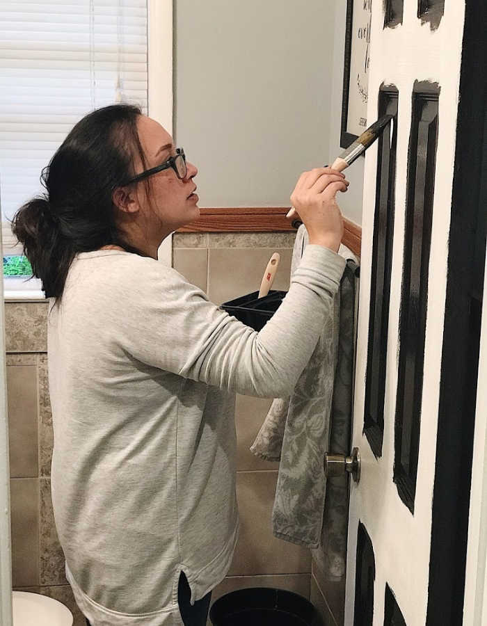 Roxanne from Catholic Homebody, painting a door