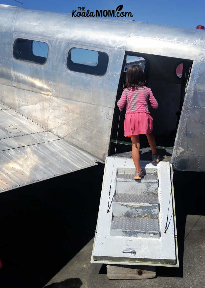 6-year-old Jade exploring a historic plane.