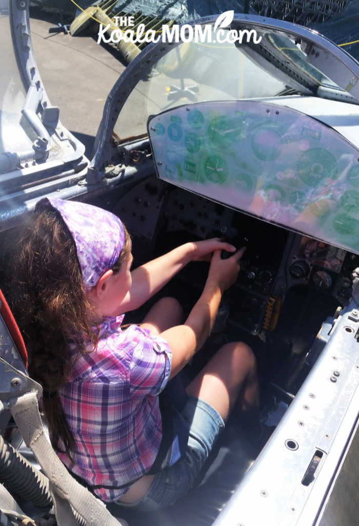 Sunshine pretending to be a fighter pilot in a World War 2 plane.
