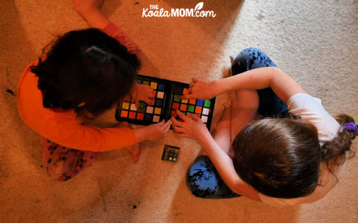 Two sisters playing Rubik's Race.