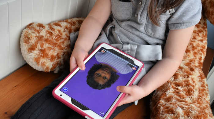 4-year-old Pearl practices new sounds and words with the Speech Blubs app on her tablet.