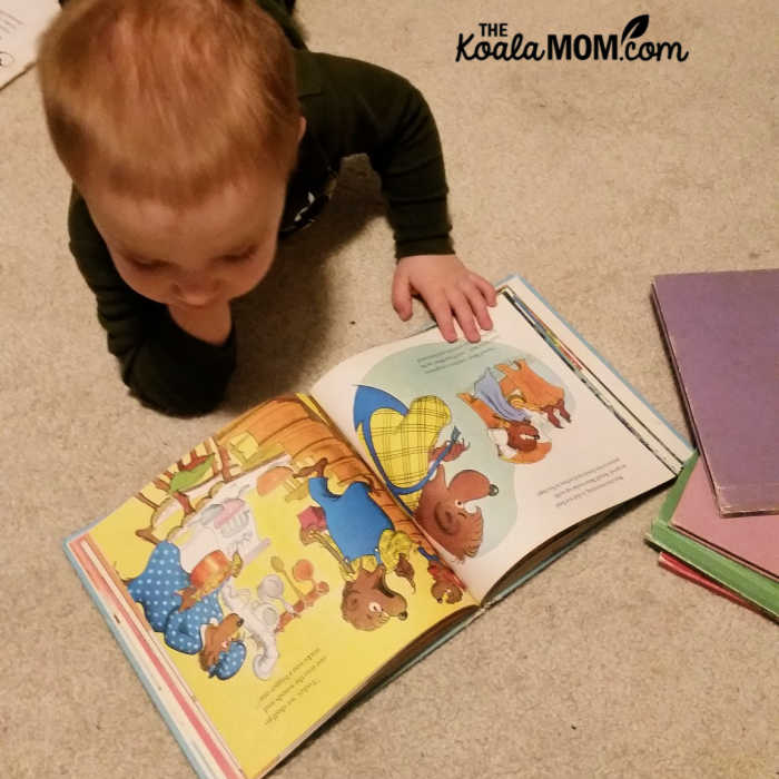 Play based preschool means leaving books where toddlers can reach them and look at when they want.