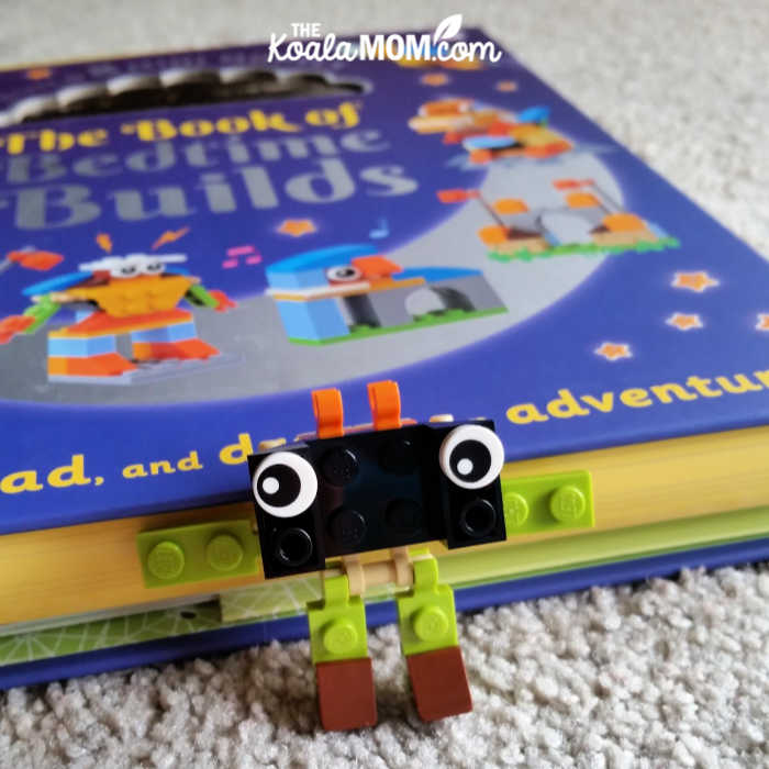 Lego minifigure with the Book of Bedtime Builds